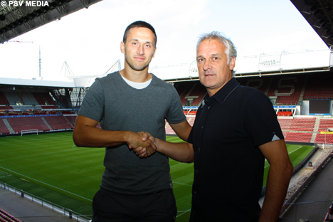 Head coach Fred Rutten shakes hands with his latest signing.