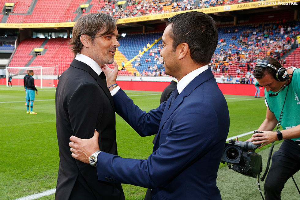 A top-0f-the-table clash Eindhoven between former team mates Phillip Cocu and Giovanni van Bronckhorst