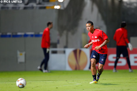 Youngster Memphis Depay delivers a cross on the well-manicured pitch at the Bloomfield Stadium.